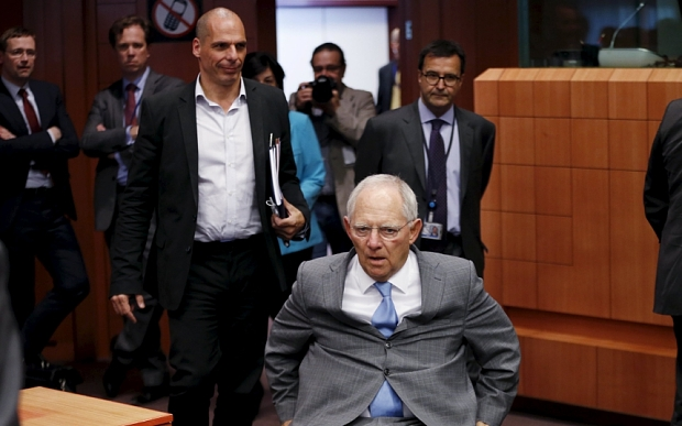 German Finance Minister Schaeuble and Greek counterpart Varoufakis arrive at an euro zone finance ministers meeting in Brussels
